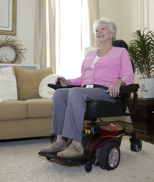 Elderly woman sitting in Pride Mobility Jazzy Select Power Wheelchair